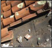 Exposed debris under clay tile roof
